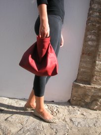 modelling the clutch bag in red