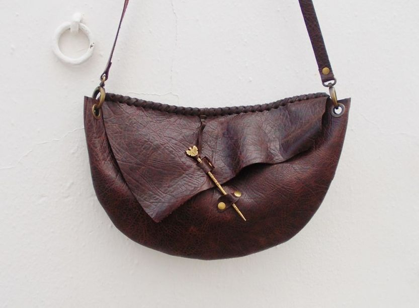 Fancy leather designed shouder bag with decorative clasp