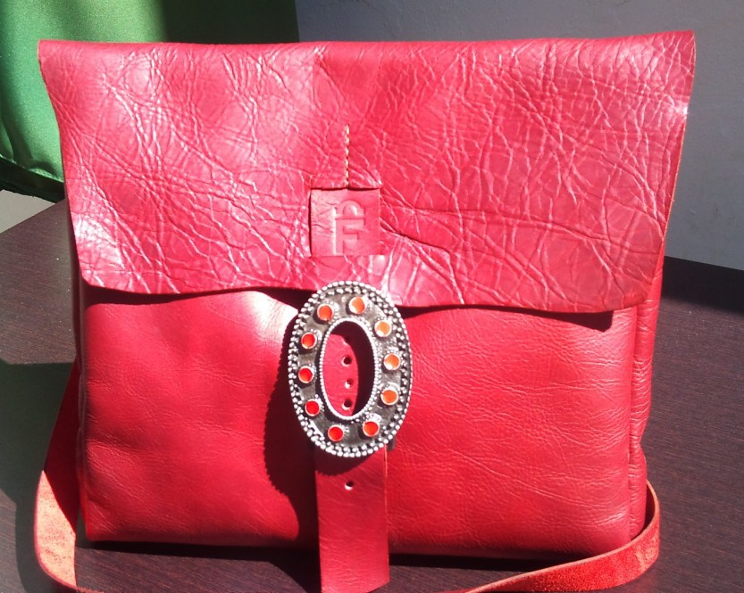 Red shoulder bag with fancy red-stone buckle