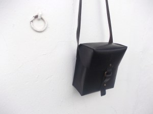 'Made to order' binoculars case made from durable, black leather.