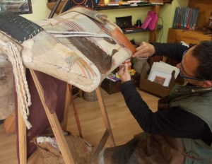Fernando repairing a mule saddle