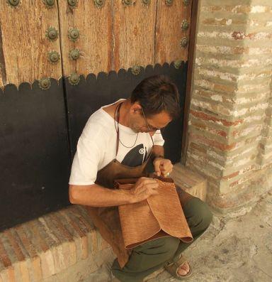 Fernando hand stiching the latest bag