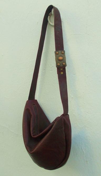 Unique squashy shoulder bag with ornate buckle.