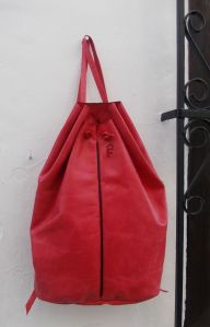 red leather rucksack with central seam by fghandmade bags