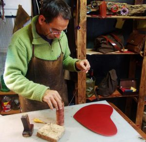 Fernando in his fg workshop starting a bag