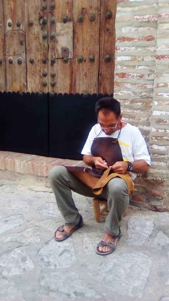 Fernando Garcia preparing a bag for stitching