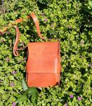 73€. 22 x 16 x 5. See link for the story behind this great shoulder bag